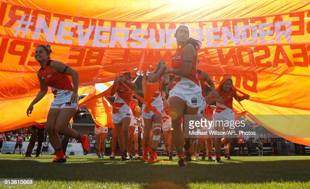 Amanda Farrugia of the Giants leads her team through the banner during the 2018 AFLW Round 01 match between the Melbourne Demons and the GWS Giants...