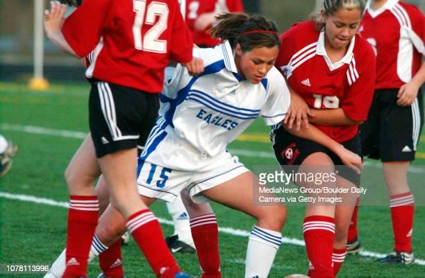 Amanda Foulk Broomfield High School fights her way through a crowd of Brighton High School players Wednesday at Elizabeth Kennedy Stadium