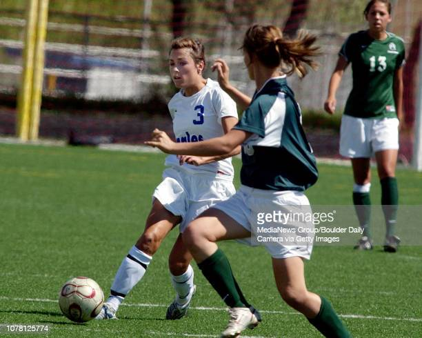 Amanda Foulk left Broomfield High School tries to get past Kelly Tynan Fossil Ridge High School during the state playoff game at Elizabeth Kennedy...