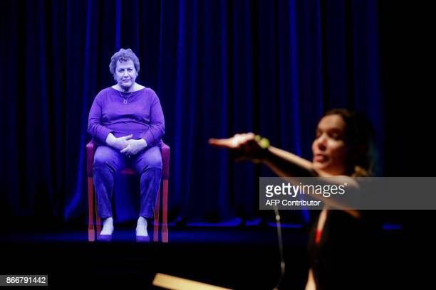 Amanda Friedeman takes a question from a student directed to Holocaust survivor Adina Sella as she is displayed as a threedimensional hologram at the...
