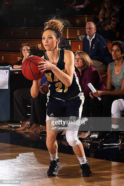 Amanda Frost of the Northern Arizona Lumberjacks scores on a threepoint jump shot against the Pepperdine Waves in the second half of the game at...