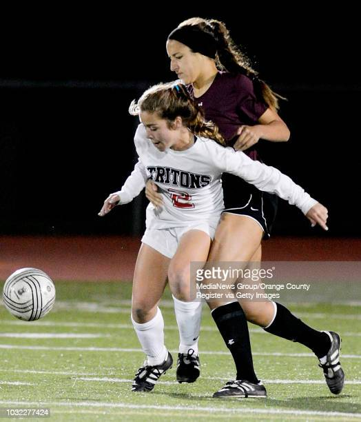 Amanda Gerrain left of San Clemente blocks out Lauren Guerra of Esperanza as they battle for the ball in the second round of the Excalibur Tournament...