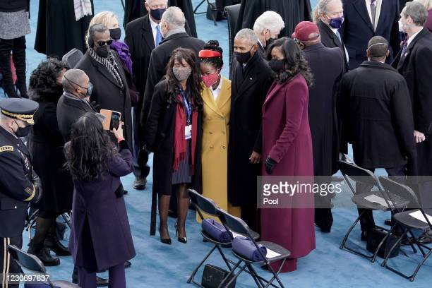 Amanda Gorman, center, takes a photo with former president Barack Obama and Michelle Obama prior to the 59th Presidential Inauguration on January 20,...