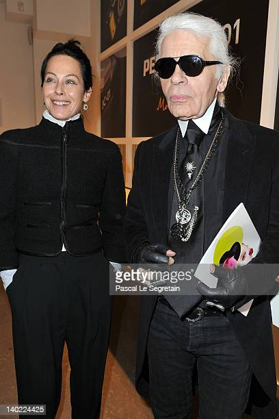 Amanda Harlech and Karl Lagerfeld attend the Marc Newson Pentax The Unveiling Of 'K01' Champagne Cocktail at Colette during Paris Fashion Week on...