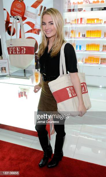 Amanda Hearst poses for a photo at the Bloomingdale's 59th Street Store to support Clarins FEED 25 bag on November 17 2011 in New York City