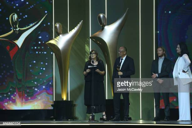 Amanda Higgs and Tony Ayres accept the AACTA Award for Best Screenplay in Television during the 7th AACTA Awards Presented by Foxtel | Ceremony at...