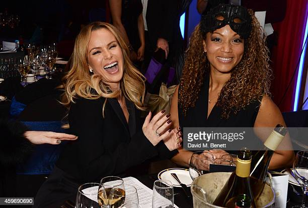 Amanda Holden and Angela Griffin attend 'The Odd Ball' 'hosted by The Murray Parish Trust at The Royal Garden Hotel on November 28 2014 in London...