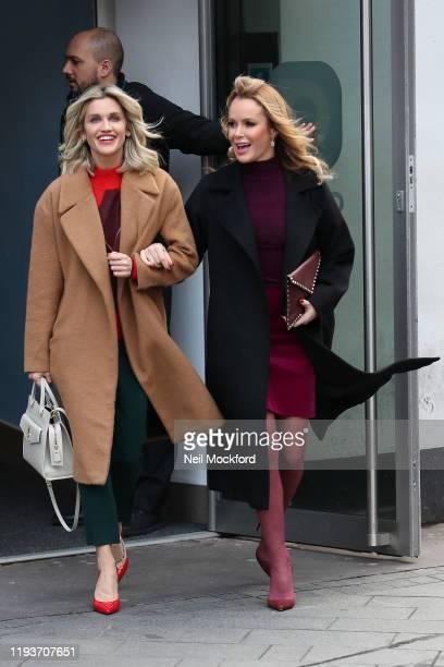 Amanda Holden and Ashley Roberts leave the Heart Breakfast Radio Studios on December 13 2019 in London England