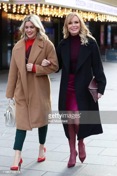 Amanda Holden and Ashley Roberts leave the Heart Breakfast Radio Studios on December 13, 2019 in London, England.