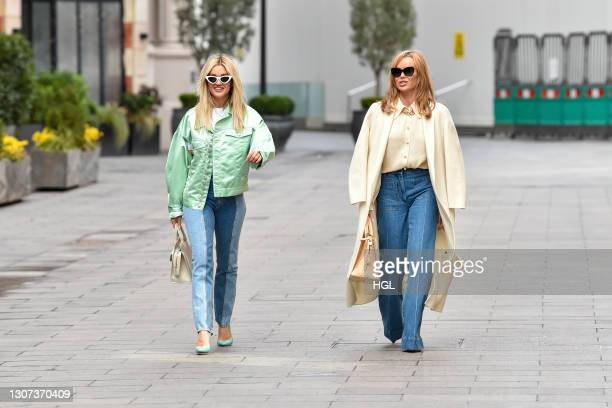 Amanda Holden and Ashley Roberts seen leaving the Global studio on March 16, 2021 in London, England.