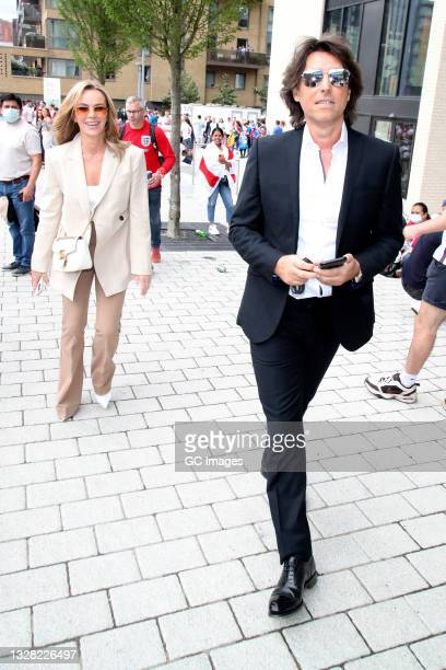 Amanda Holden and Chris Hughes arriving at Wembley Stadium for The EURO 2020 Final on July 11, 2021 in London, England.