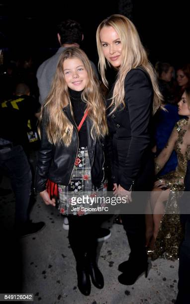 Amanda Holden and daughter Lexi attend the Julien Macdonald show during London Fashion Week September 2017 on September 18 2017 in London England