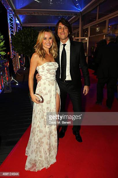 """Amanda Holden and husband Chris Hughes attend Battersea Dogs & Cats Home's """"Collars & Coats Gala Ball"""" at Battersea Evolution on October 30, 2014 in..."""