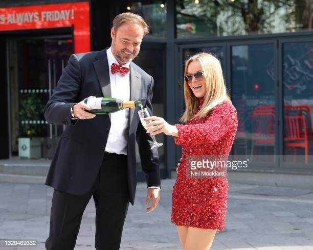 Amanda Holden and Jamie Theakston posing outside Heart Radio Studios as they celebrate Heart's Make Me a Millionaire Competition winner on May 28,...