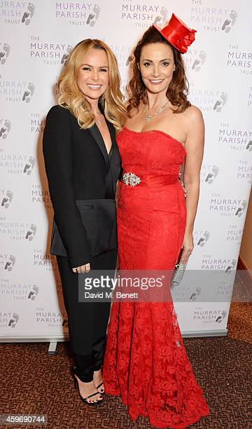 Amanda Holden and Sarah Parish attend 'The Odd Ball' 'hosted by The Murray Parish Trust at The Royal Garden Hotel on November 28 2014 in London...