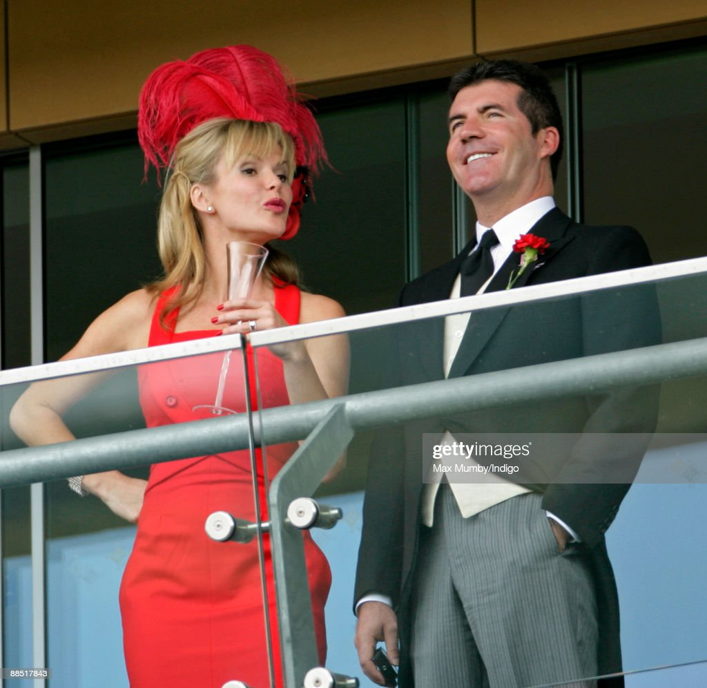 Amanda Holden and Simon Cowell watch the racing from a balcony as they attend Royal Ascot at Ascot Racecourse on June 16, 2009 in Ascot, England.