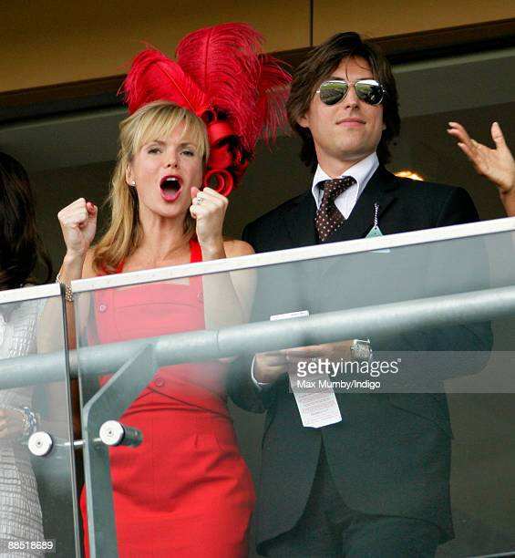Amanda Holden cheers whilst watching the racing from a balcony as she and husband Chris Hughes attend Royal Ascot at Ascot Racecourse on June 16 2009...