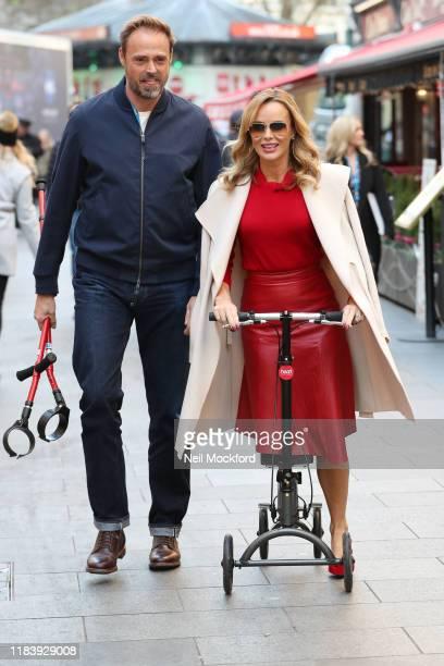 Amanda Holden leaving Heart Radio Studios with a broken leg on October 28, 2019 in London, England.