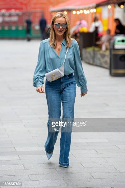Amanda Holden seen at Global Radio in jeans with a rainbow on in support Pride month on June 30, 2021 in London, England.