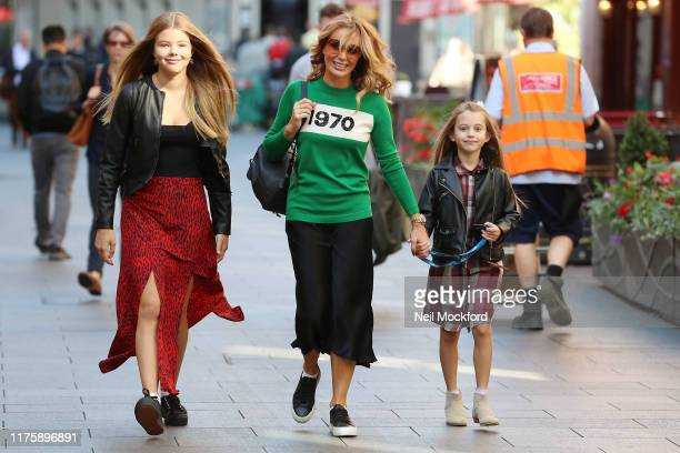 Amanda Holden seen leaving Heart Radio Studios with her daughters on September 20, 2019 in London, England.