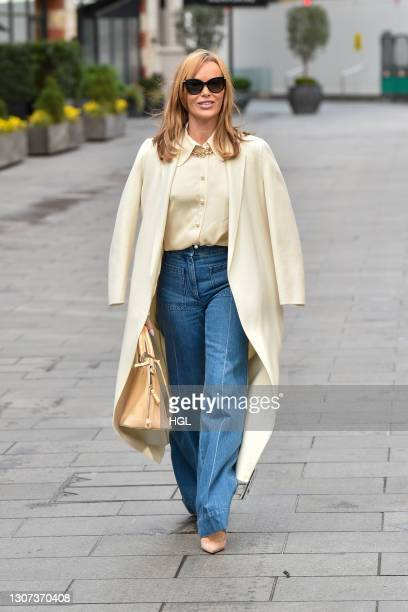 Amanda Holden seen leaving the Global studios on March 16, 2021 in London, England.