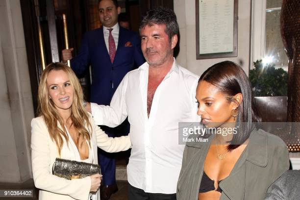 Amanda Holden Simon Cowell and Alesha Dixon at 34 restaurant for Richard Holloway's going away party on January 25 2018 in London England