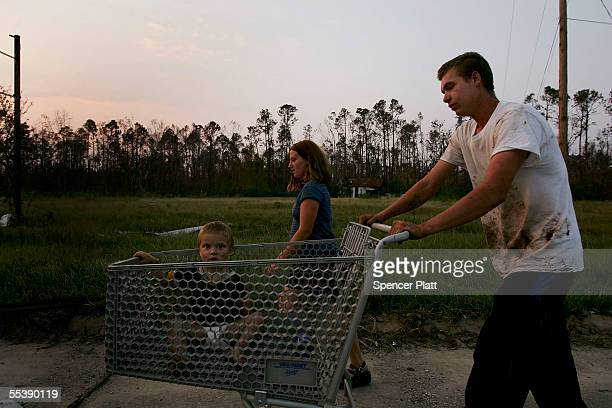 Amanda Hudson and Robert Corkern walk along the highway with Hudsons twoyearold child Willie September 12 2005 in Waveland Mississippi The couple who...