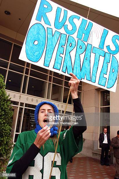 Amanda Huron wears a Philadelphia Eagles jersey as she protests Rush Limbaugh's appearance at the National Association of Broadcaste October 2 2003...