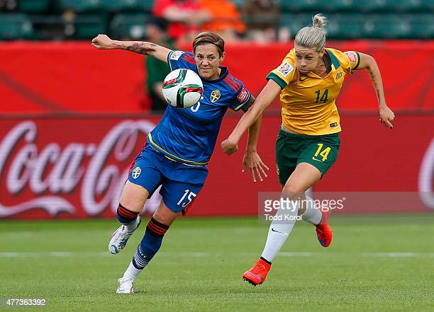 Amanda Ilestedt of Australia and Teresa Polias of Sweden race for the ball during the FIFA Women's World Cup Canada Group D match between Australia...