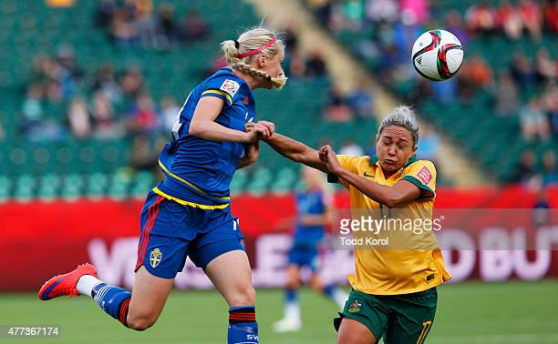 Amanda Ilestedt of Sweden heads thew ball past Kyah Simon of Australia during the FIFA Women's World Cup Canada Group D match between Australia and...