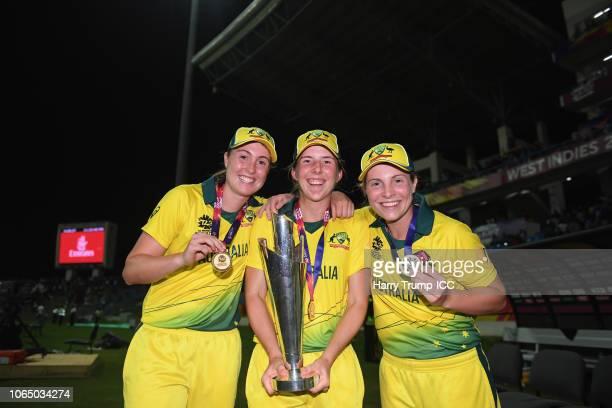 Amanda JadeWellington Georgia Wareham and Sophie Molineux of Australia celebrate with the trophy during the ICC Women's World T20 2018 Final between...