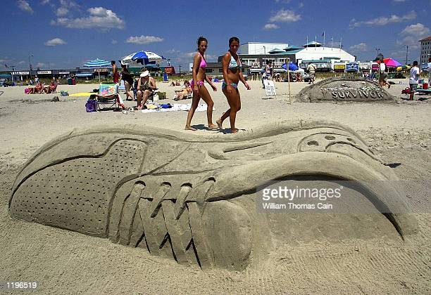 Amanda Jordan 17yearsold and Allison Sachs 17yerasold of Washington Twp New Jersey view a larger then life sand sculpted sneaker during a sand...