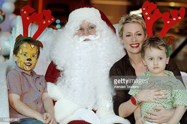 Amanda Keller poses with Santa Claus at Bondi Junction Westfield on November 16 2007 in Sydney Australia