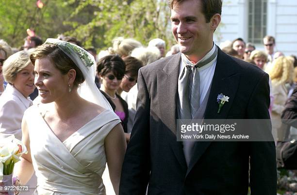Amanda Kennedy Smith and Carter Hood beam after their wedding at Queen of the Most Holy Rosary Church in Bridgehampton LI Amanda who has a PhD in...