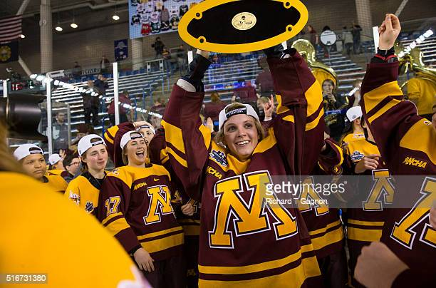 Amanda Kessel of the Minnesota Golden Gophers raises the championship trophy after winning the 2016 NCAA Division I Women's Hockey Frozen Four...