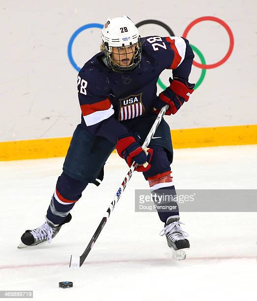 Amanda Kessel of the United States handles the puck in the first period against Sweden during the Women's Ice Hockey Playoffs Semifinal game on day...