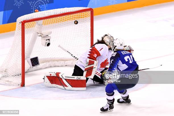 Amanda Kessel of the United States scores a goal against Shannon Szabados of Canada in the overtime penaltyshot shootout during the Women's Gold...