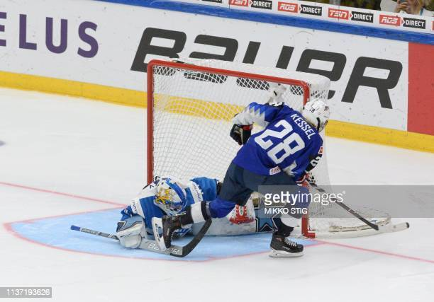Amanda Kessel of the United States scores a shootout goal past goalkeeper Noora Räty of Finland during the IIHF Women's Ice Hockey World...