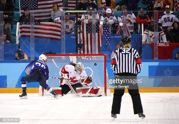 Amanda Kessel of the United States scores against Shannon Szabados of Canada in the overtime penaltyshot shootout during the Women's Gold Medal Game...