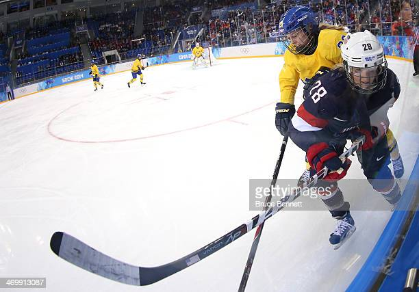 Amanda Kessel of the United States skates against Michelle Lowenhielm of Sweden in the third period during the Women's Ice Hockey Playoffs Semifinal...
