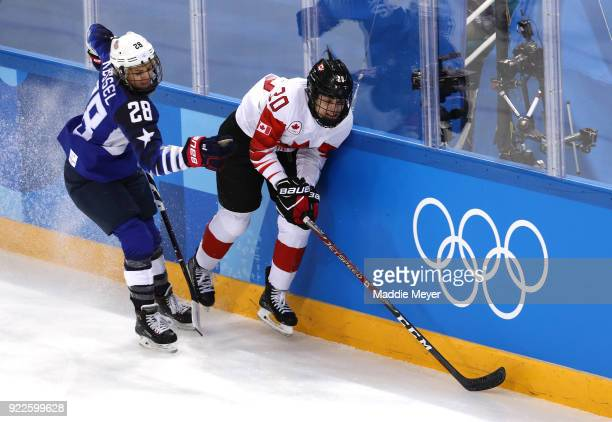 Amanda Kessel of the United States skates against Sarah Nurse of Canada in the first period during the Women's Gold Medal Game on day thirteen of the...