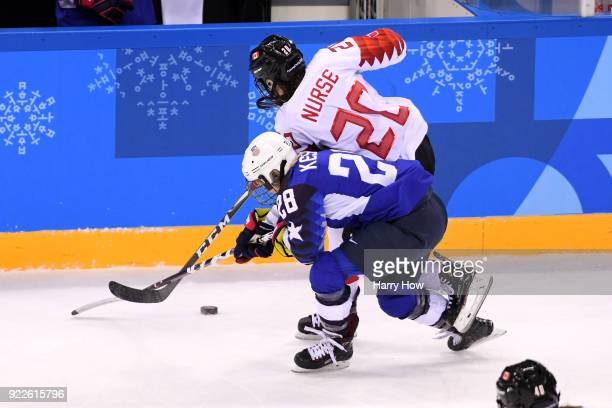 Amanda Kessel of the United States skates against Sarah Nurse of Canada in the second period during the Women's Gold Medal Game on day thirteen of...