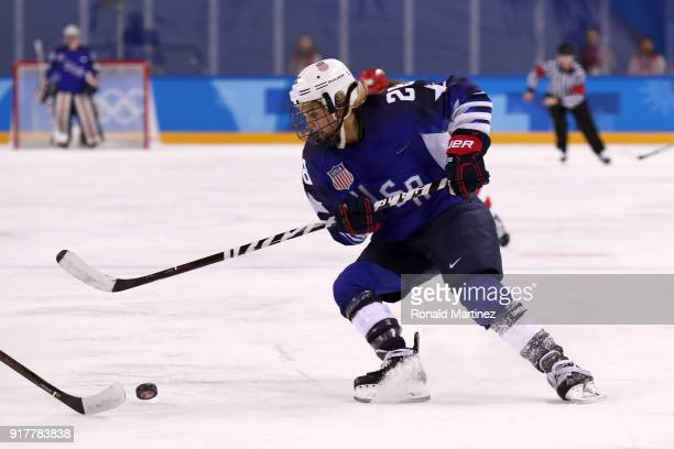 Amanda Kessel of the United States skates with the puck against Olympic Athletes from Russia during the Women's Ice Hockey Preliminary Round Group A...