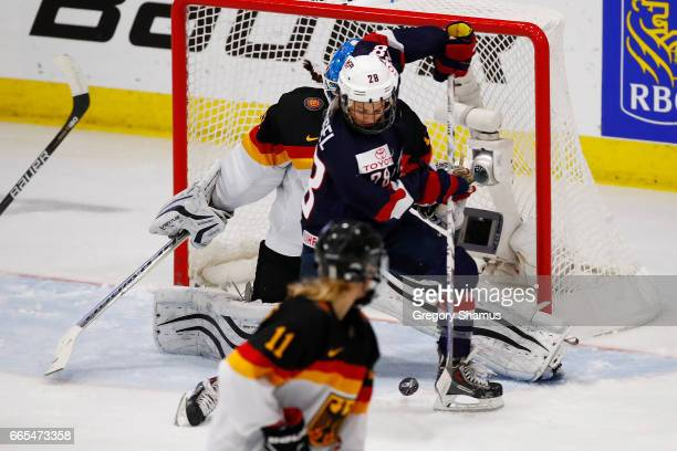 Amanda Kessel of the United States tries to get a shot off in front of Ivonne Schroder of Germany during the second period of a semifinal game at the...
