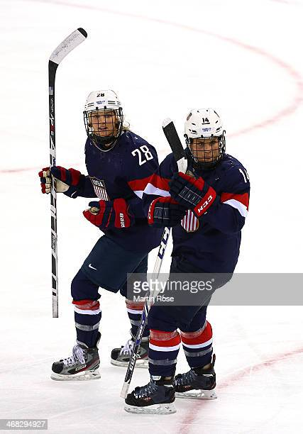 Amanda Kessel of United States celebrates with teammate Brianna Decker of United States after scoring her team's fifth goal in the first period...
