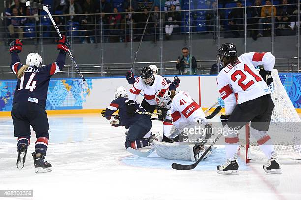 Amanda Kessel of United States scores her team's eighth goal past Florence Schelling of Switzerland during the Women's Ice Hockey Preliminary Round...
