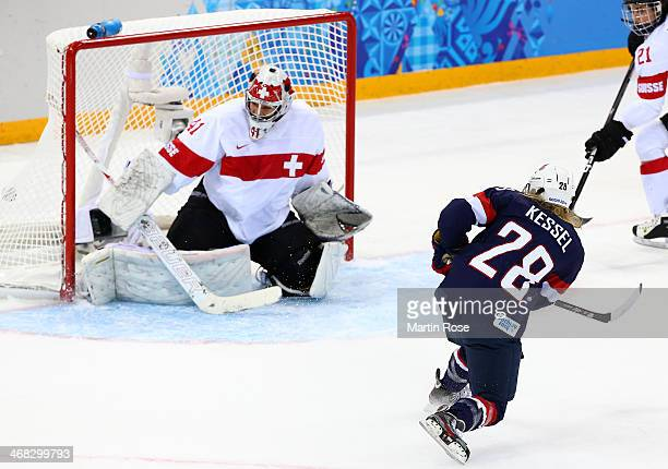 Amanda Kessel of United States scores her team's fifth goal in the first period during the Women's Ice Hockey Preliminary Round Group A game on day...