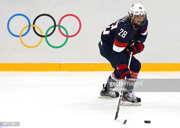 Amanda Kessel of United States skates with the puck against Finland during the Women's Ice Hockey Preliminary Round Group A Game on day 1 of the...