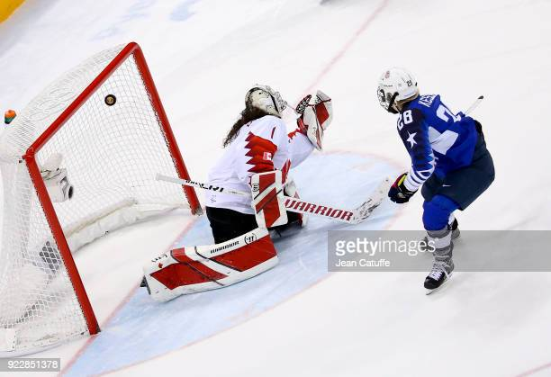 Amanda Kessel of USA scores against goalkeeper of Canada Shannon Szabados during penaltyshot shootout of the Women's Ice Hockey Gold Medal game final...