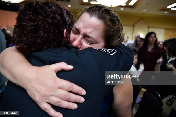 Amanda King gets a hug from her teary eyed mom Billie Jo Braun after the badge ceremony during the Denver Sheriff Academy Class of 20163 during its...